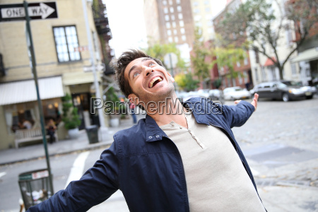 man expressing happiness and screaming in