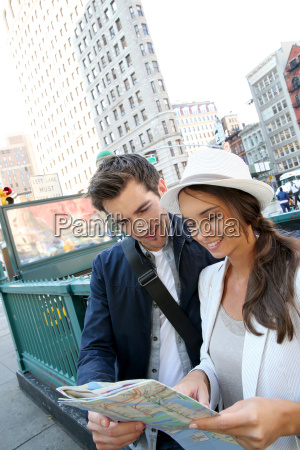couple looking at city map by
