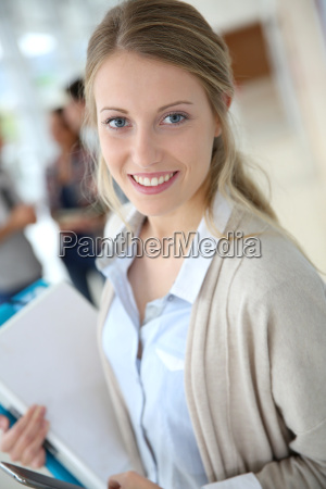 young woman in school campus using