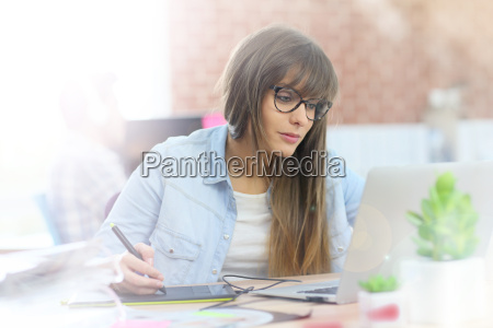 young woman working with graphic tablet