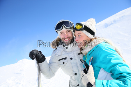 cheerful couple of skiers ready to