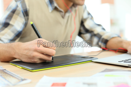 closeup on designer using graphic tablet