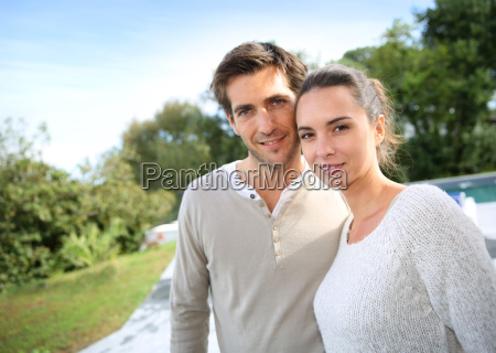 couple standing outside in front of