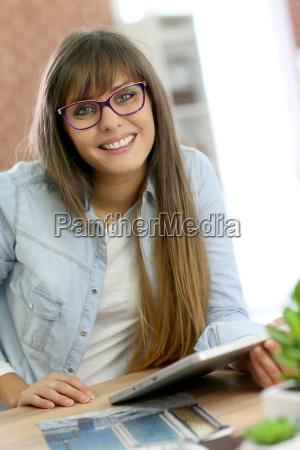 student girl using digital tablet in