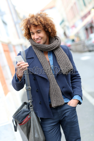 trendy smiling man talking on phone