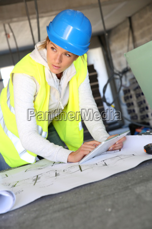 woman architect on building site using
