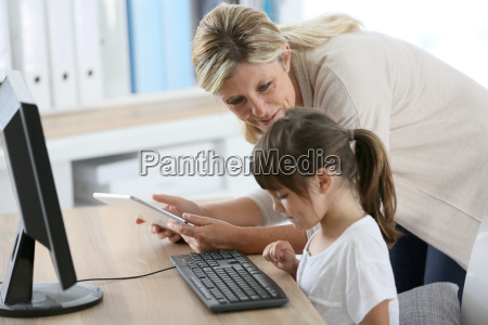 teacher with little girl in class