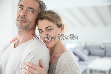 happy mature couple in brand new