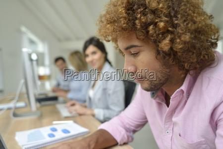 young businessman in office working on