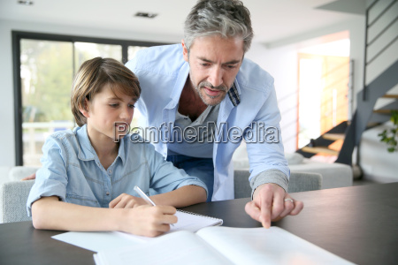 father helping son with homework
