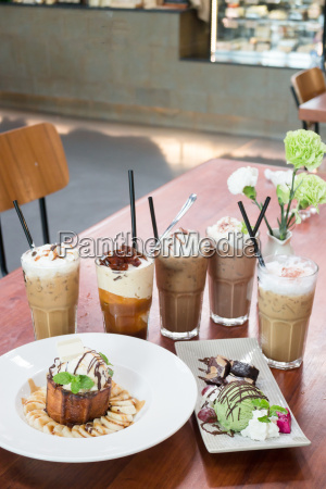 variety iced coffee drinks on wooden