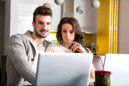 young couple with a laptop pc