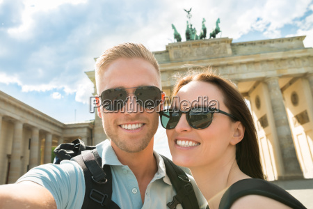 young couple taking selfie in front