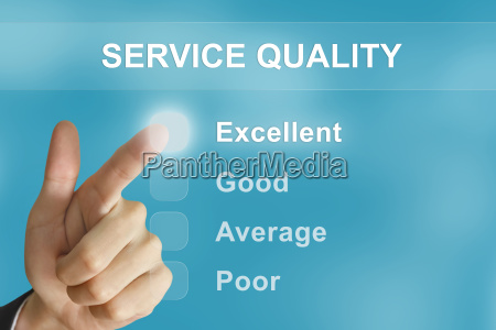 business hand pushing service quality button