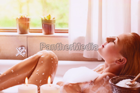 woman relaxing in the bathtub