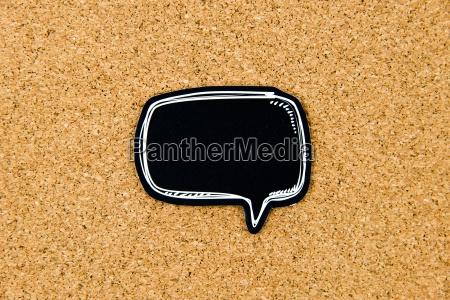 empty black speech bubble over cork