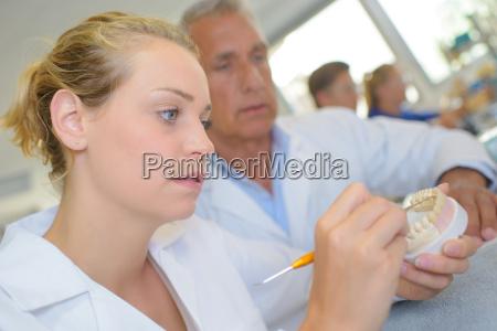 woman making dentures