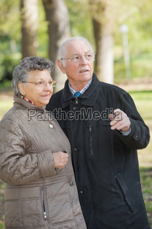 elderly couple in the woods