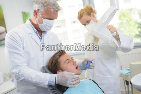 young man having dental checkup