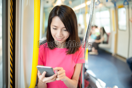 young woman looking at cellphone inside