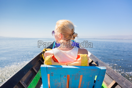 female tourist travels by traditional boat