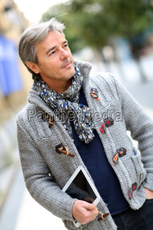 mature man walking in shopping street