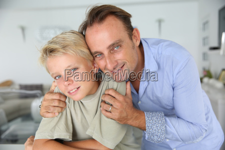 portrait of father embracing son