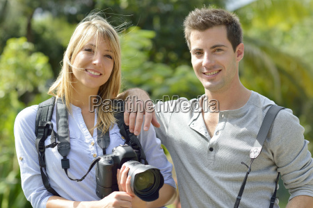 cheerful young photographers on a training