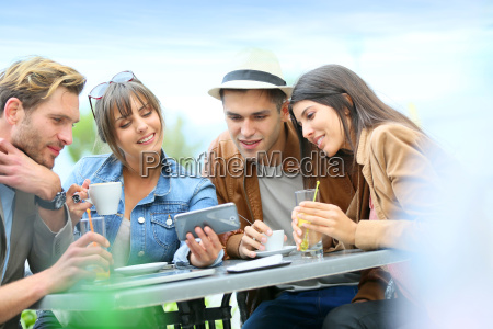 young people at coffee shop table