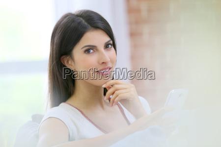 portrait of brunette girl using smartphone