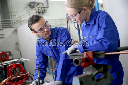 young people in plumbing professional training