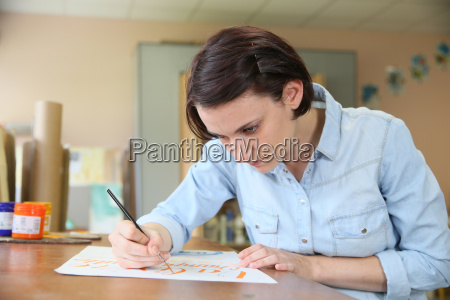 young woman at school studying decorative