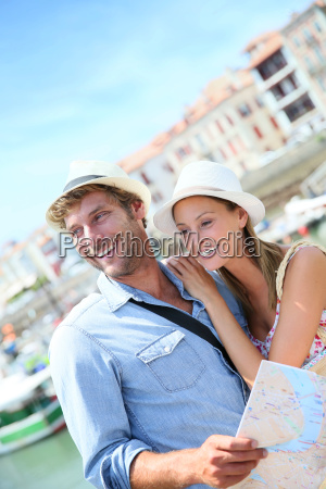 couple of tourists at seaside resort