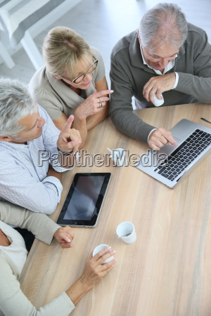 group of retired senior people using