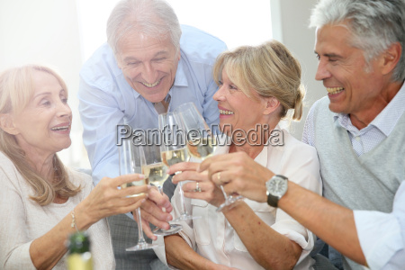 group of senior people celebrating with