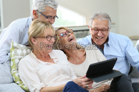 group of senior friends with eyeglasses