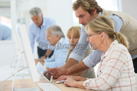 group of senior people attending computing