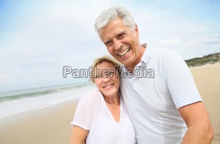 married senior couple having fun walking