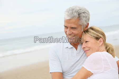 in love senior couple embracing at