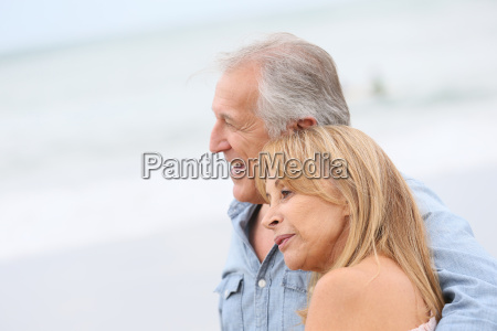 married senior couple walking in the