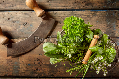mezzaluna knife with basket of fresh