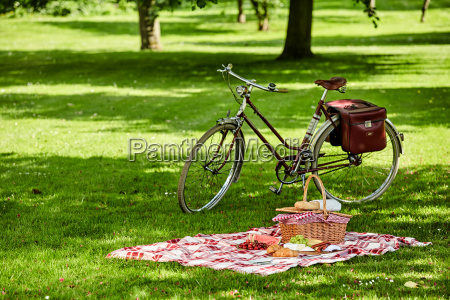 bicycle and picnic spread in a