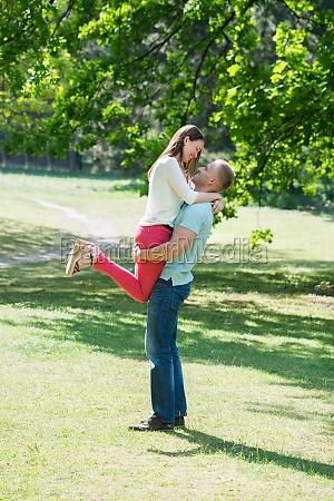 man lifting woman