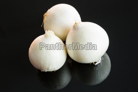 fresh peeled raw onions on a