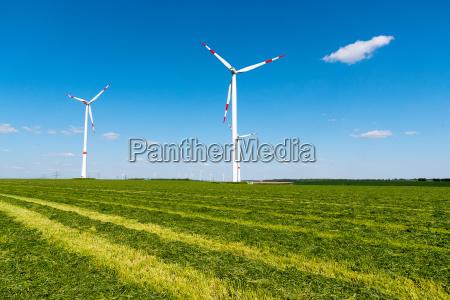 wind turbines in a mown field