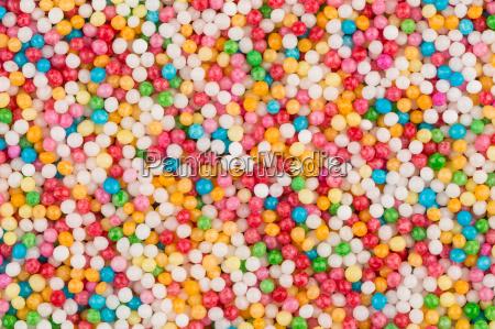 schuss von bunten zuckerkugeln