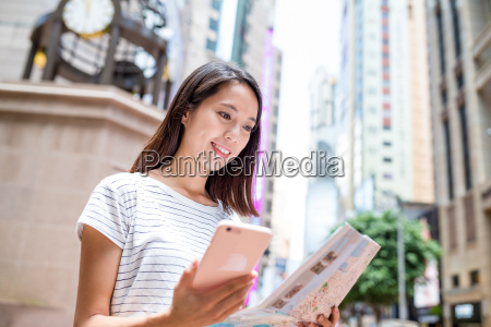 woman looking at city map with