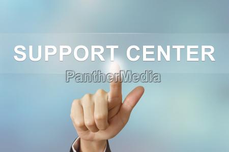 business hand clicking support center button