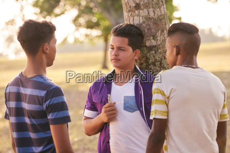 group of teens in park boy
