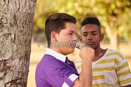 group of teens smokers boy smoking